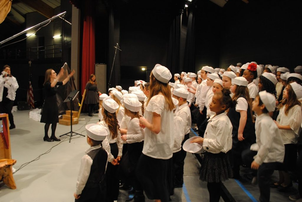 Carolyn leading the children's choir backstage at Operation Arctic