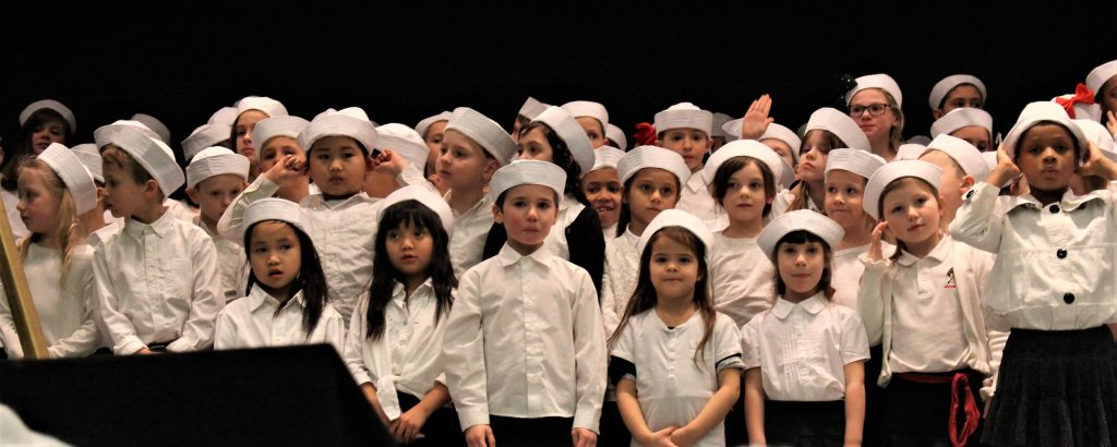 This image has an empty alt attribute; its file name is kids-choir-1-1024x410.jpg